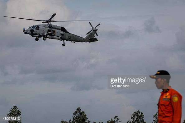 Navy helicopter carrying four victims of AirAsia flight QZ 8501 prepares to land at Iskandar Airbase on January 02 2015 in Pangkalan Bun Central...