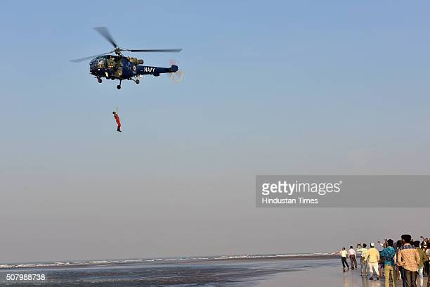 A navy helicopter conducting aerial search operation to locate the body of a college student who drowned along with 13 of his colleagues off the...