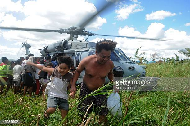 Navy helicopter delivers relief goods to typhoon victims in the aftermath of typhoon Haiyan in Ormoc on the eastern island of Leyte on November 18...