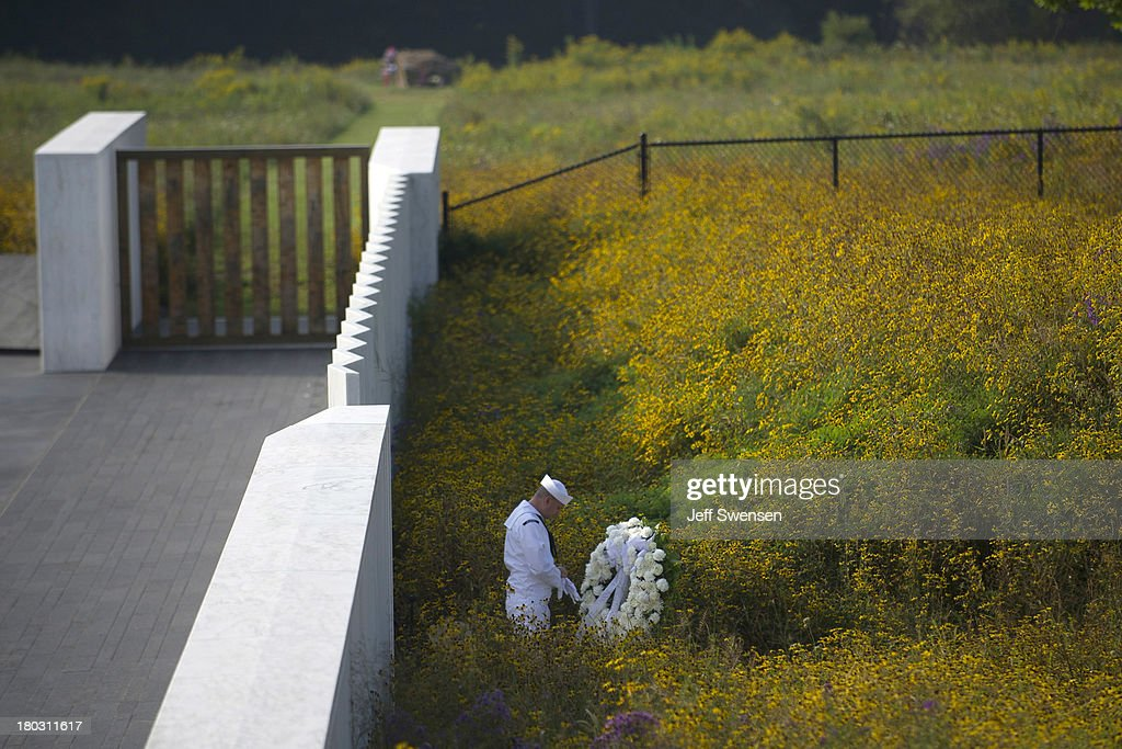 A Navy honor guard prepares a wreath before the arrival of United States Secretary of the Interior Sally Jewell at the Flight 93 National Memorial during ceremonies commemorating the 12th anniversary of the 9/11 attacks on September 11, 2013 in Shanksville, Pennsylvania. The nation is commemorating the anniversary of the 2001 attacks, which resulted in the deaths of nearly 3,000 people after two hijacked planes crashed into the World Trade Center, one into the Pentagon in Arlington, Virginia and one crash landed in Shanksville, Pennsylvania.