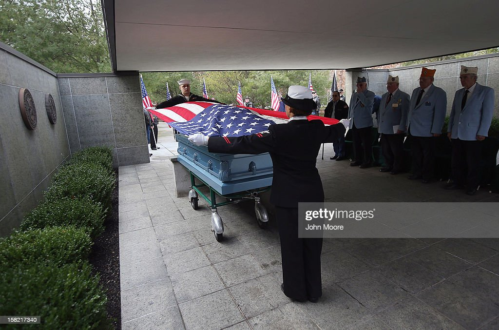 S. Navy honor guard removes an American flag from the casket of Hurricane Sandy victim David Maxwell before his burial at the Calverton National Cemetery on December 11, 2012 near the Wading River hamlet of Long Island, New York. Maxwell, 66, was the last of Sandy's victims found on the Staten Island borough of New York City, when his body was discovered in his Midland Beach home 11 days after the storm. A Vietnam veteran, he was buried at the national cemetery, accompanied by honor guards from the Catholic War Veterans and the Patriot Guard Riders.