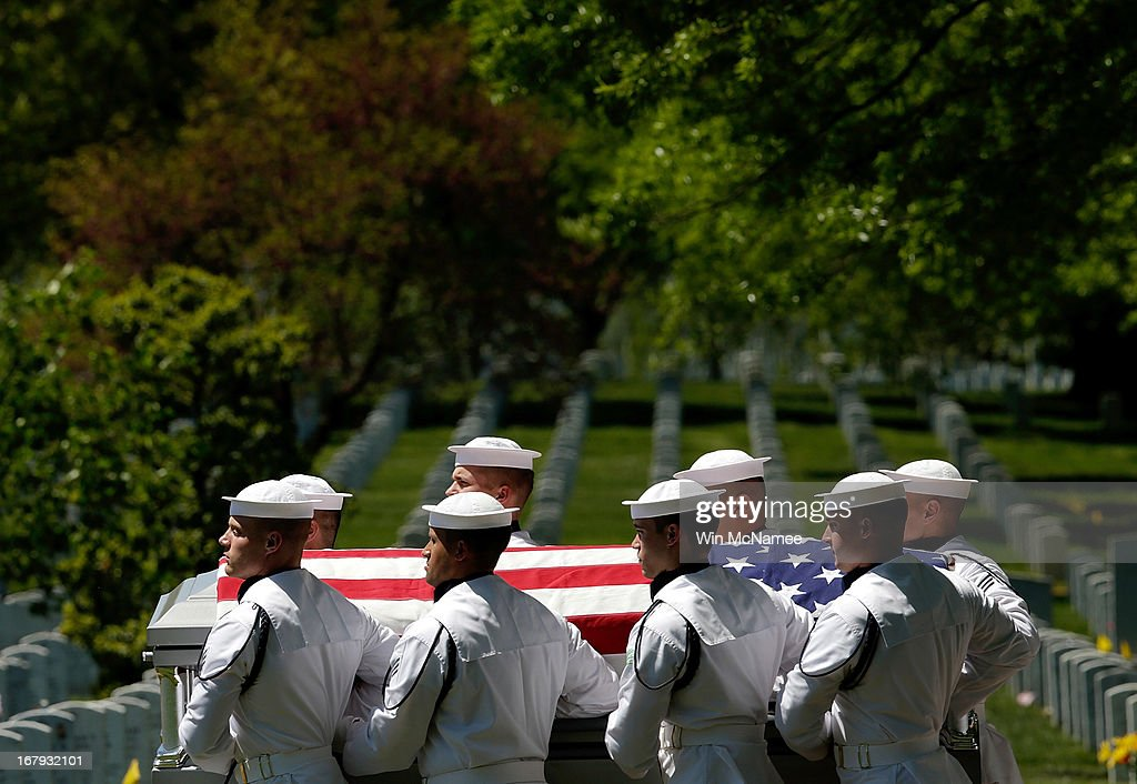 S. Navy honor guard team carries a casket with the remains of four sailors missing since a helicopter crash during the Vietnam War in July 1967 at a full military honors burial service at Arlington National Cemetery May 2, 2013 in Arlington, Virginia. The remains of Lt. Dennis Peterson, Ensign Donald Frye, Aviation Antisubmarine Warfare Technician William Jackson and Aviation Antisubmarine Warfare Technician Donald McGrane were buried together during the service.