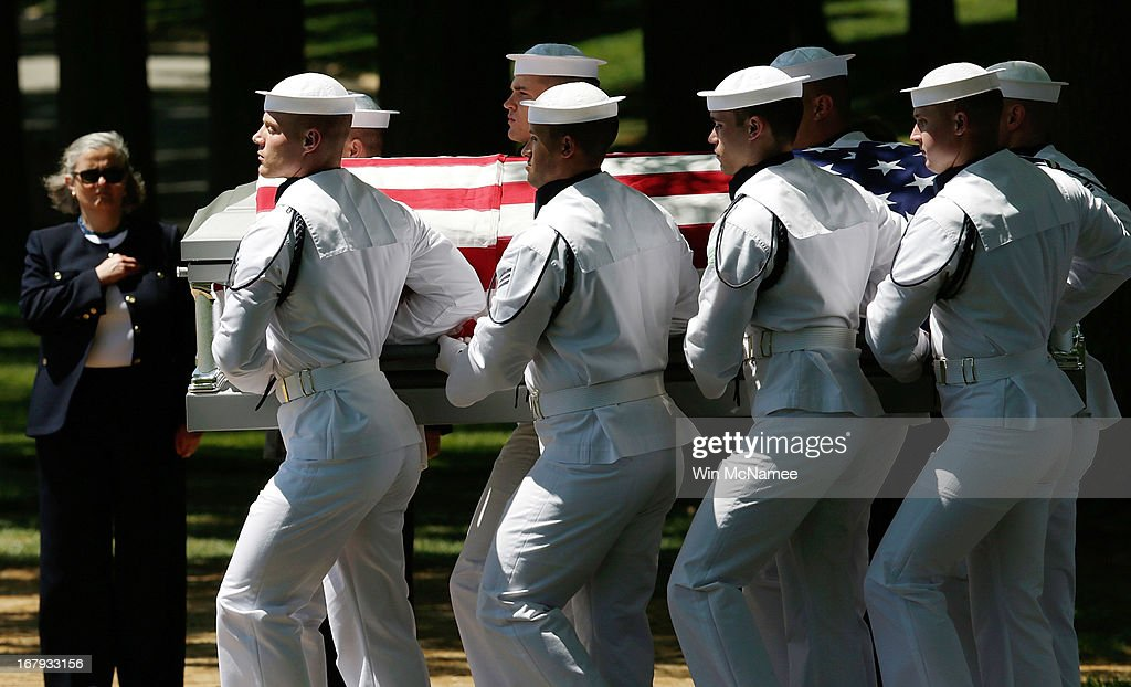 S. Navy honor guard team carries a casket with the remains of four sailors missing since a helicopter crash during the Vietnam War in July 1967 at a full military honors burial service at Arlington National Cemetery May 2, 2013 in Arlington, VA. The remains of Lt. Dennis Peterson, Ensign Donald Frye, Aviation Antisubmarine Warfare Technician William Jackson and Aviation Antisubmarine Warfare Technician Donald McGrane were buried together during the service.
