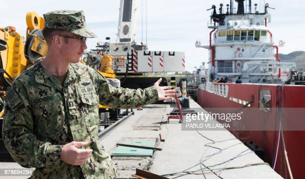 US Navy Karl Schonberd gestures next to the Sophie Siem vessel where members of the US Navy Undersea Rescue Command will install the Submarine Rescue...