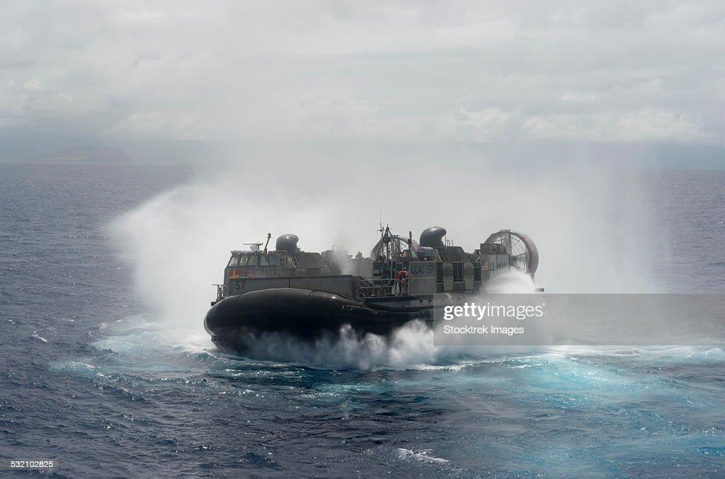 A U.S. Navy landing craft air cushion at high speed.