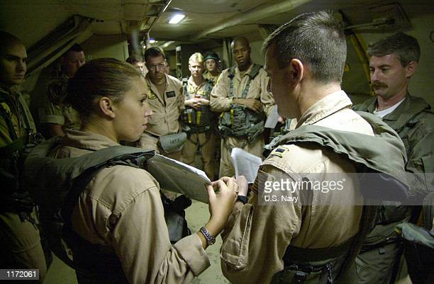 S Navy Lt jg John Greer and Aviation Systems Warfare Operator 3rd Class Mandy Florez brief a mission plan to crew members October 27 2001 prior to...