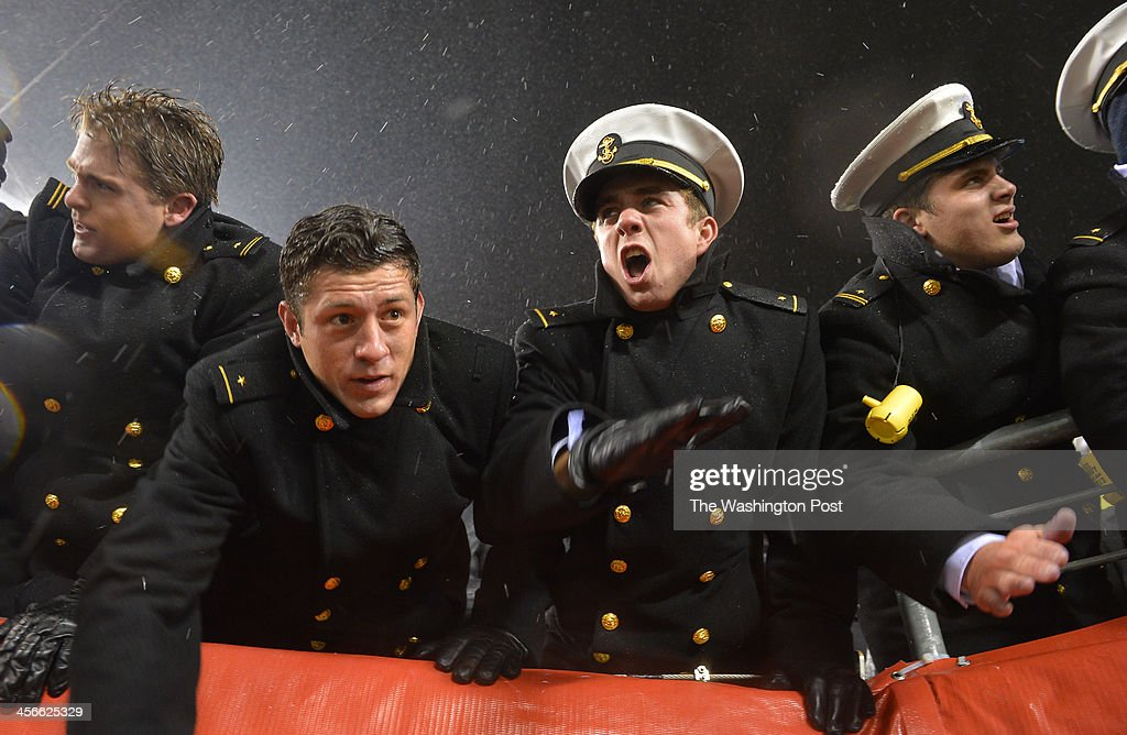 Navy Midshipmen cheer after a touchdown against Army in the fourth quarter during the annual Army-Navy football game at Lincoln Financial Field on December 14, 2013 in Philadelphia, Pa. Navy beat Army 34-7.
