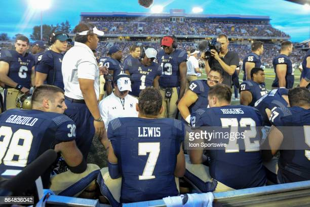 Navy Midshipmen head coach Ken Niumatalolo talks with offensive unit in the second half on October 21 at Navy Marine Corps Memorial Stadium in...