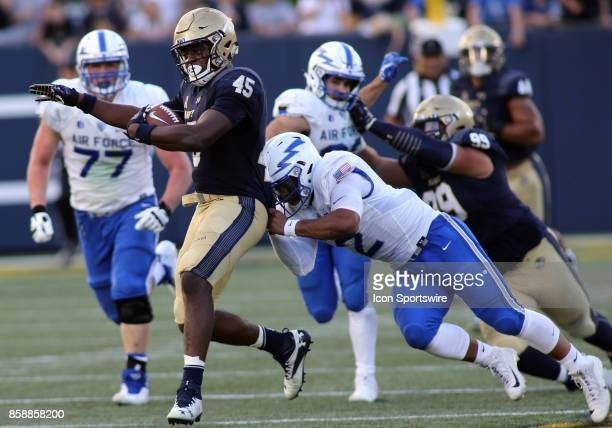 Navy Midshipmen linebacker DJ Palmore returns a fumble during a match between Navy and Air Force on October 07 at NavyMarine Corps Memorial Stadium...