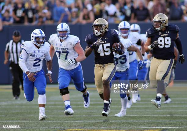 Navy Midshipmen linebacker DJ Palmore returns a fumble past several Air Force Falcons defenders during a match between Navy and Air Force on October...