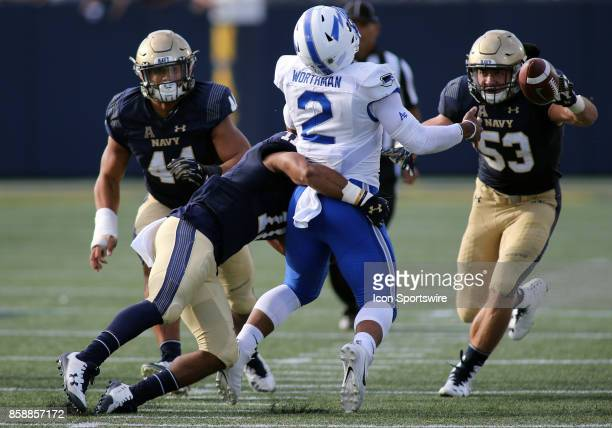 Navy Midshipmen linebacker Jerry Thompson forces Air Force Falcons quarterback Arion Worthman to fumble during a match between Navy and Air Force on...