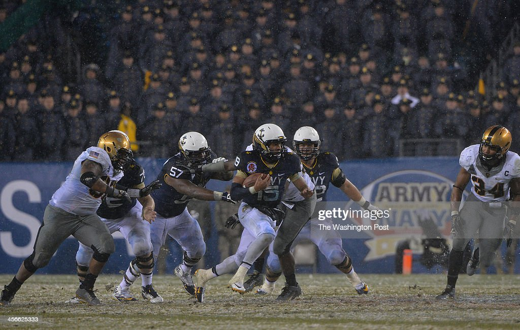 Navy Midshipmen quarterback Keenan Reynolds (19) carries the ball for yardage in the third quarter against Army during the annual Army-Navy football game at Lincoln Financial Field on December 14, 2013 in Philadelphia, Pa. Navy beat Army 34-7.