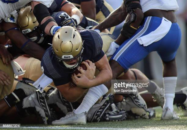 Navy Midshipmen quarterback Zach Abey attempts to cross the goal line for a touchdown during a match between Navy and Air Force on October 07 at...