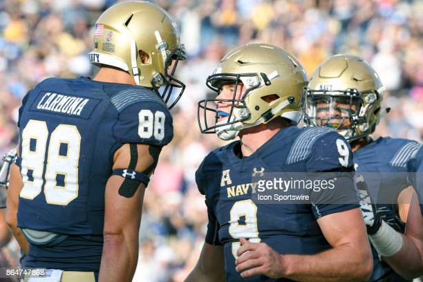 Navy Midshipmen quarterback Zach Abey is congratulated by wide receiver Tyler Carmona after running for a second quarter touchdown against the UCF...
