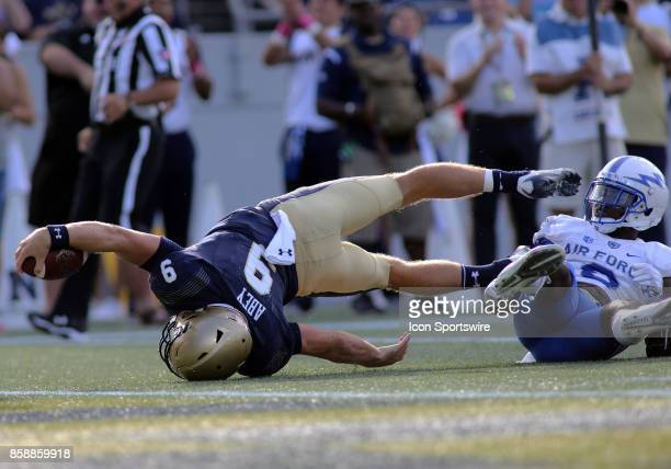 Navy Midshipmen quarterback Zach Abey reaches past the goal line during a match between Navy and Air Force on October 07 at NavyMarine Corps Memorial...