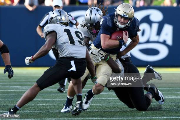 Navy Midshipmen quarterback Zach Abey runs for a first down in the second quarter against UCF Knights linebacker Shaquem Griffin on October 21 at...