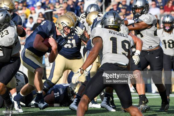Navy Midshipmen quarterback Zach Abey runs for a second quarter touchdown against the UCF Knights defense on October 21 at Navy Marine Corps Memorial...