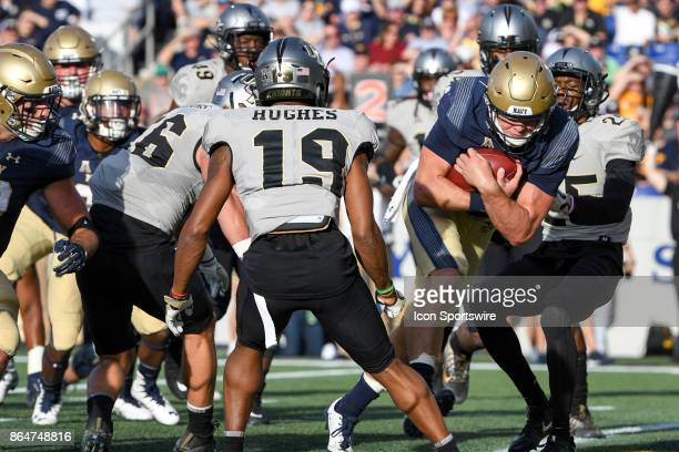 Navy Midshipmen quarterback Zach Abey runs for a second quarter touchdown against UCF Knights defensive back Kyle Gibson on October 21 at Navy Marine...