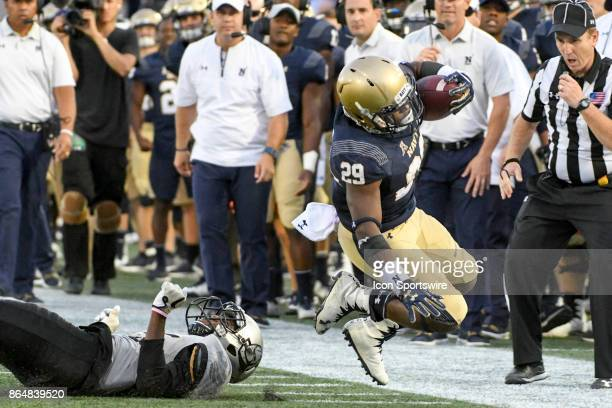 Navy Midshipmen running back Darryl Bonner makes a pass reception and is forced out of bounds in the second half on October 21 at Navy Marine Corps...