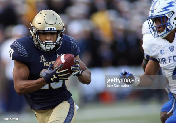 Navy Midshipmen running back Malcolm Perry catches a touchdown pass during a match between Navy and Air Force on October 07 at NavyMarine Corps...