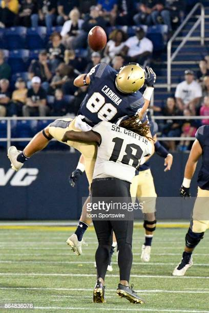 Navy Midshipmen wide receiver Tyler Carmona cannot make a catch as he is defended by UCF Knights linebacker Shaquem Griffin on October 21 at Navy...