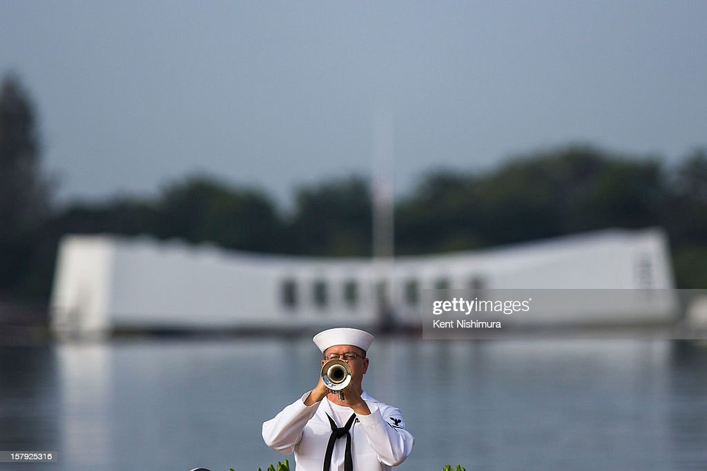 S. Navy musician plays echo 'Taps' in front of the U.S.S. Arizona Memorial during the 71st Annual Memorial Ceremony commemorating the WWII Attack On Pearl Harbor at the World War 2 Valor in the Pacific National Monument December 7, 2012 in Pearl Harbor, Hawaii. This is the 71st anniversary of the Japanese attack on Pearl Harbor.