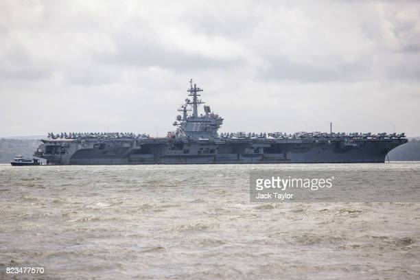 Navy Nimitzclass aircraft carrier USS George HW Bush is pictured anchored off the coast on July 27 2017 in Portsmouth England The 100000 ton ship...