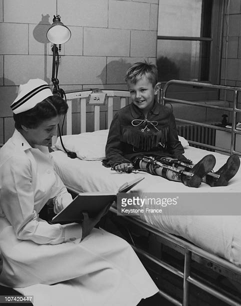 Navy Nurse With A Disabled Child Cared For Polio In Hospital In Usa On 1957