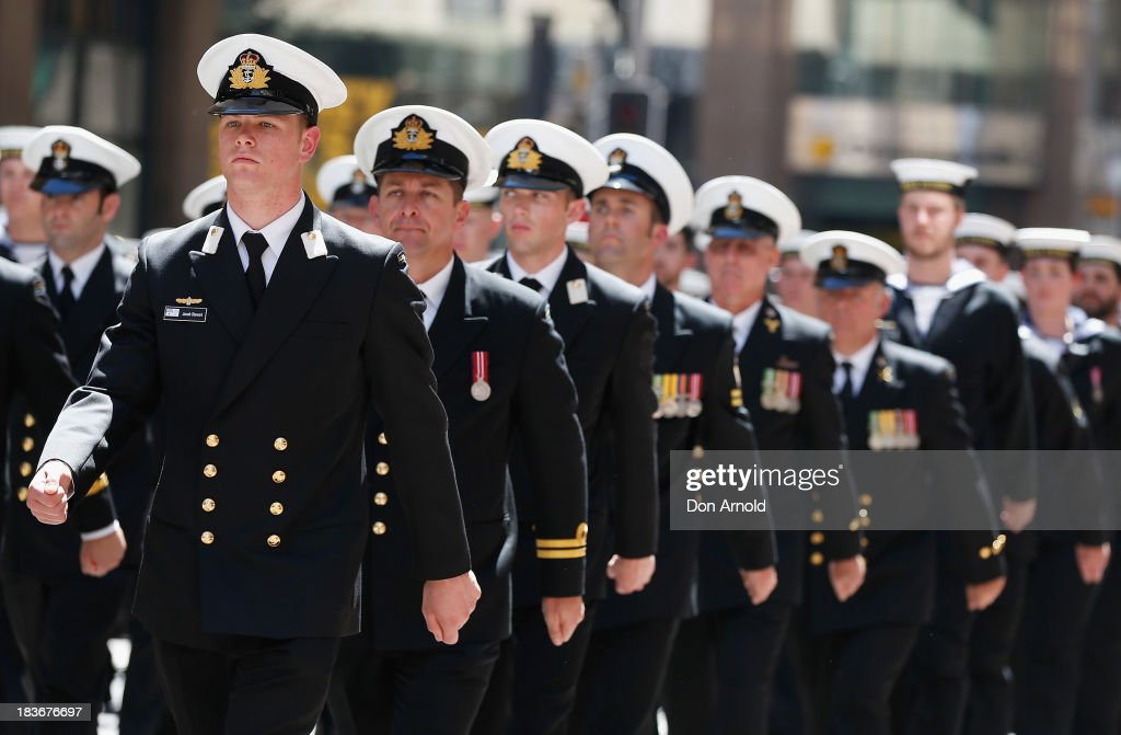 Navy personnel from HMAS Sydney march down George Street on October 9, 2013 in Sydney, Australia. Over 4,000 personnel paraded through the streets of Sydney just one day before the end of International Fleet Review in Sydney.