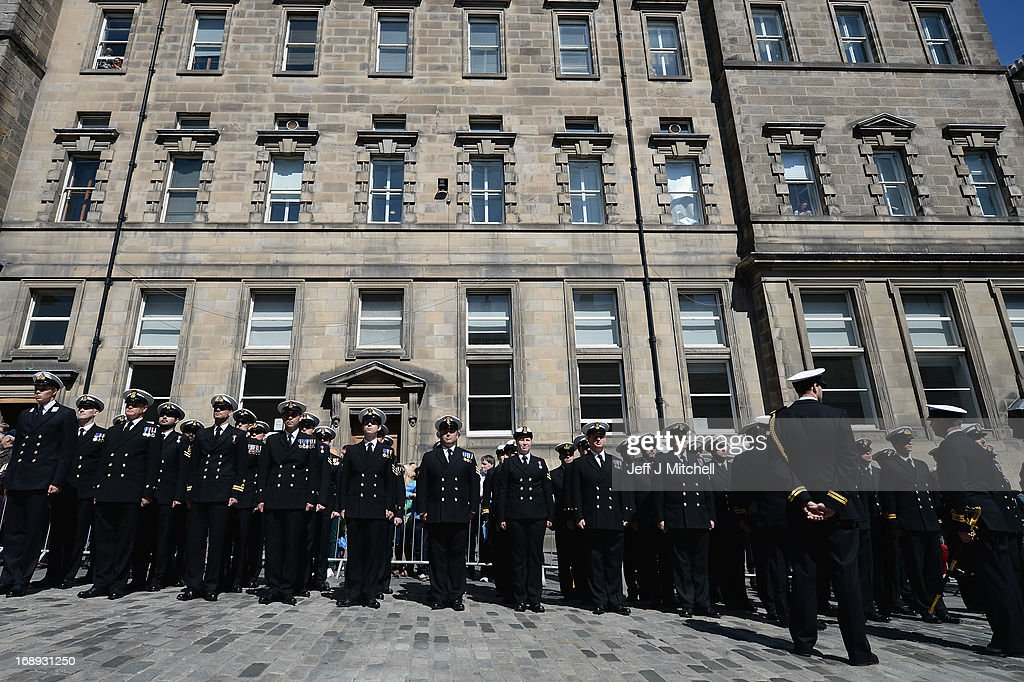 Navy personnel from HMS Edinburgh stand at attention on the Royal Mile during a Parade and presentation of Privilege to celebrate the ships decommissioning on May 17, 2013 in Edinburgh, Scotland.The Type 42 Destroyer, HMS Edinburgh is visiting the Edinburgh as part of a farewell tour which will end in Portsmouth next month.