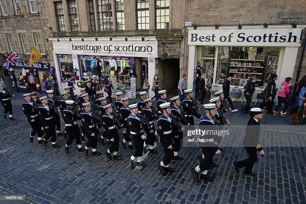 Navy personnel from HMS Edinburgh walk up the Royal Mile during a Parade and presentation of Privilege to celebrate the ships decommissioning on May 17, 2013 in Edinburgh, Scotland. The Type 42 Destroyer, HMS Edinburgh is visiting the Edinburgh as part of a farewell tour which will end in Portsmouth next month.