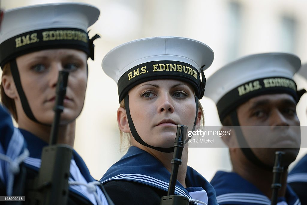 Navy personnel from HMS Edinburgh walk up the Royal Mile during a Parade and presentation of Privilege to celebrate the ships decommissioning on May 17, 2013 in Edinburgh, Scotland.The Type 42 Destroyer, HMS Edinburgh is visiting the Edinburgh as part of a farewell tour which will end in Portsmouth next month.