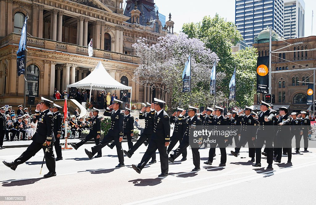 Navy personnel from HTMS Krabi salute the Governor-General as they march down George Street on October 9, 2013 in Sydney, Australia. Over 4,000 personnel paraded through the streets of Sydney just one day before the end of International Fleet Review in Sydney.