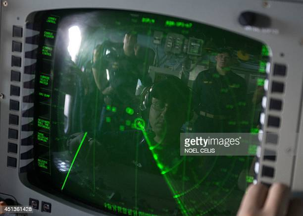 US Navy personnel looks at the radar system during the bilateral maritime exercise between the Philippine Navy and US Navy dubbed Cooperation Afloat...