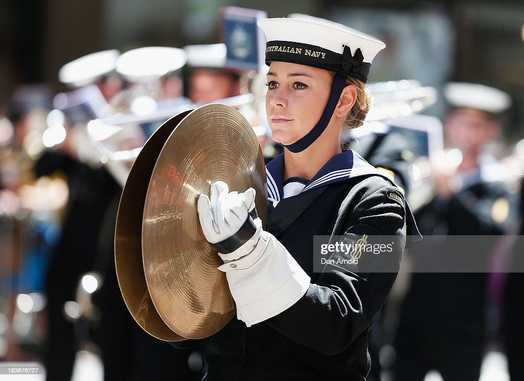 Navy personnel march down George Street on October 9, 2013 in Sydney, Australia. Over 4,000 personnel paraded through the streets of Sydney just one day before the end of International Fleet Review in Sydney.