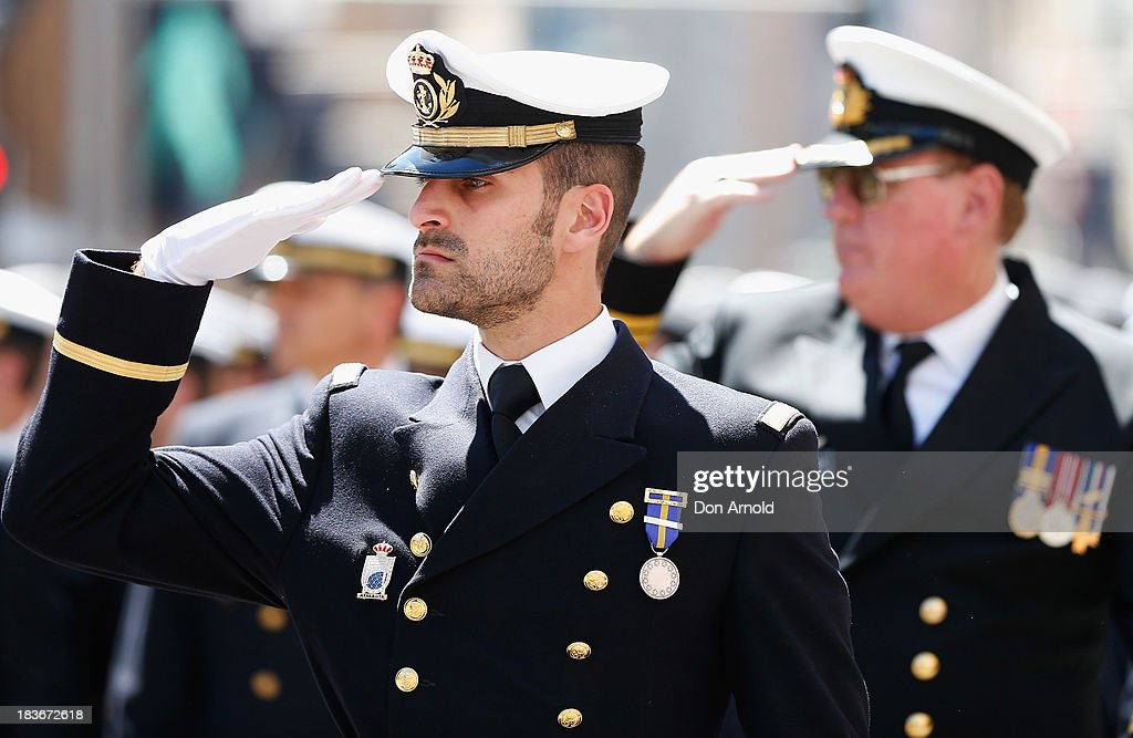 Navy personnel salute the Governor-General as they march down George Street on October 9, 2013 in Sydney, Australia. Over 4,000 personnel paraded through the streets of Sydney just one day before the end of International Fleet Review in Sydney.