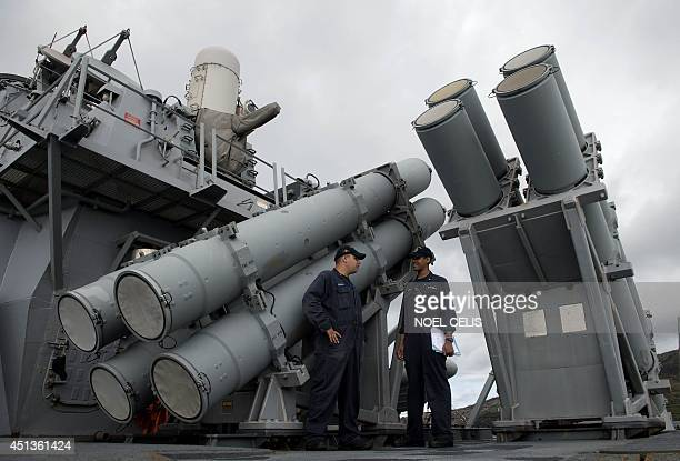 US Navy personnel stand in front of a guided missile launcher during the bilateral maritime exercise between the Philippine Navy and US Navy dubbed...