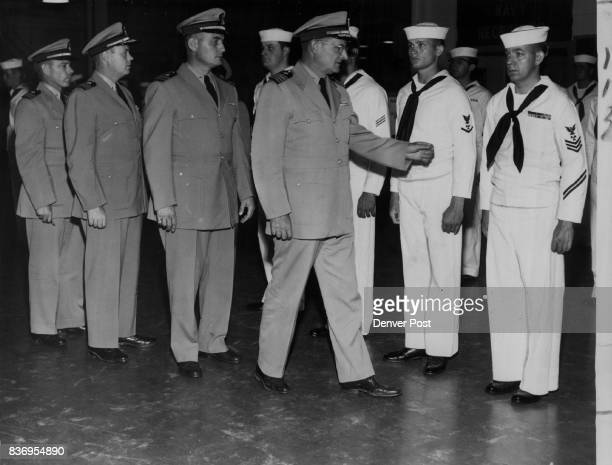 Navy Reserve Denver Officers left to right Lt Cmdr R J McCloskey Cmdr HE Long Lt Cmdr A C Kimmell Capt J S Champlin Enlisted men left to right...