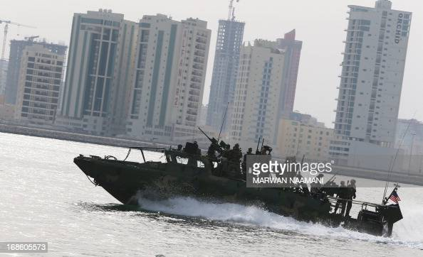 Navy Riverine Command Boat cruises off the coast of Bahrain's Salman port near the capital Manama on May 12 one day before the start of the biggest...