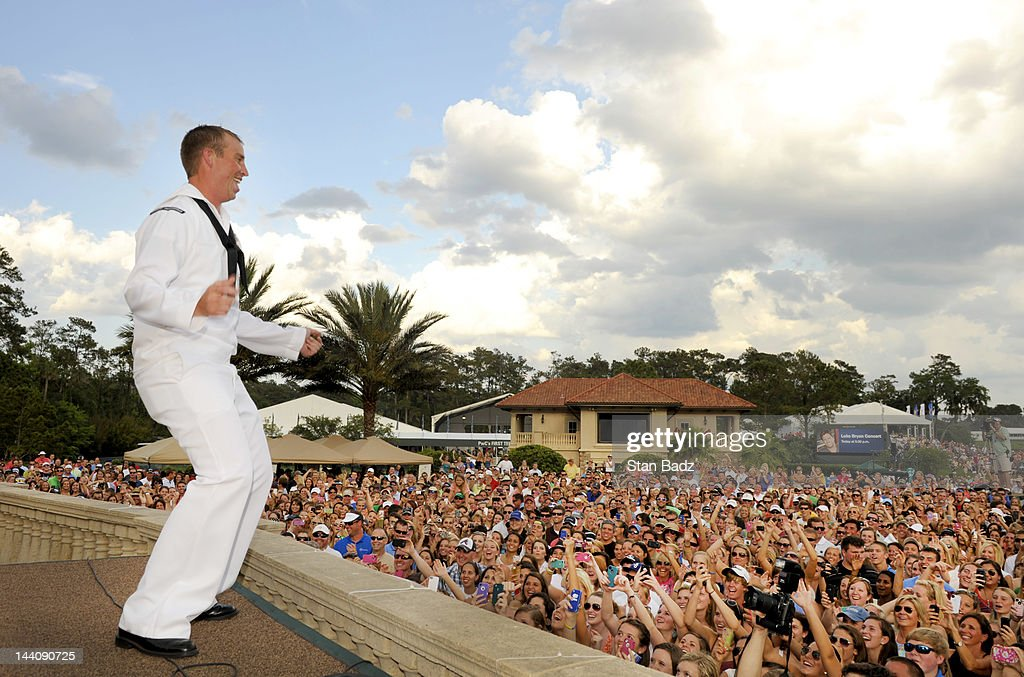 US Navy sailor performs on stage during Military Appreciation Day at THE PLAYERS Championship on THE PLAYERS Stadium Course at TPC Sawgrass on May 9, 2012 in Ponte Vedra Beach, Florida.