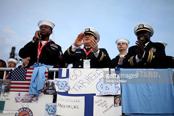 Navy Sailors cheer during the University of North Carolina v Michigan State game aboard the Aircraft Carrier USS Vinson during the Carrier Classic on...