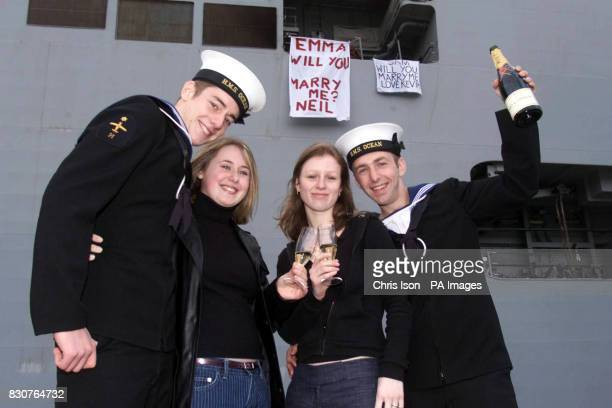Navy sailors Neil Talbot and Kevin Gregory after proposing to their girlfriends from the deck of HMS Ocean as they return to Devonport docks in...
