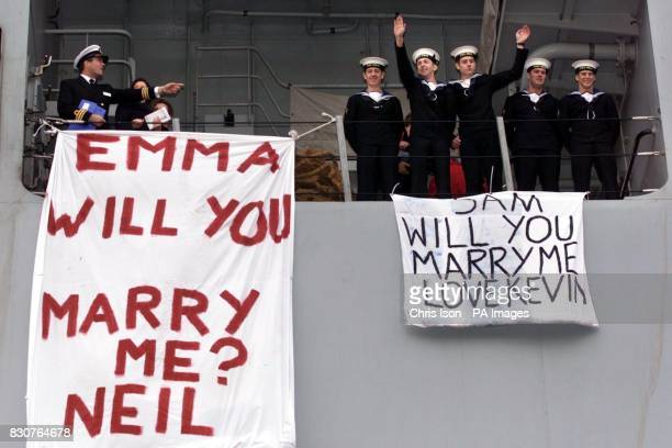 Navy sailors Neil Talbot and Kevin Gregory propose to their girlfriends from the deck of HMS Ocean as they return to Devonport docks in Plymouth *The...