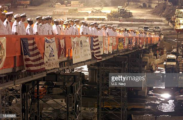 S Navy Sailors visiting New York during the 15th annual Fleet Week celebration render honors at 'Ground Zero' as the final steel beam was removed...