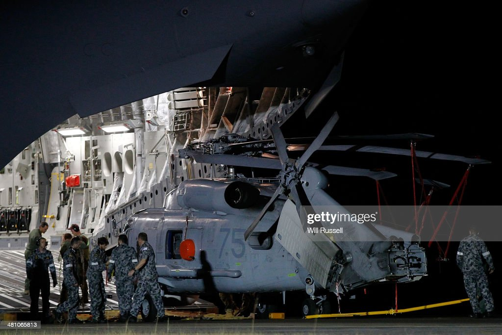 A Navy Seahawk helicopter is offloaded from a RAAF C17 Globemaster aircraft at the RAAF base in Bullsbrook on March 28, 2014 in Perth, Australia. The Australian Maritime Safety Authority (AMSA) announced today the search area for missing flight MH370 has shifted closer to the Western Australian Coast after receiving radar analysis suggesting the airliner did not travel as far south as originally thought. The Malaysian airliner disappeared on March 8 with 239 passengers and crew on board and is suspected to have crashed into the southern Indian Ocean.