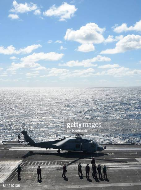 Navy Seahawk helicopter prepares to take off from the deck of the USS Ronald Reagan on July 14 2017 in Townsville Australia USS Ronald Reagan is a...