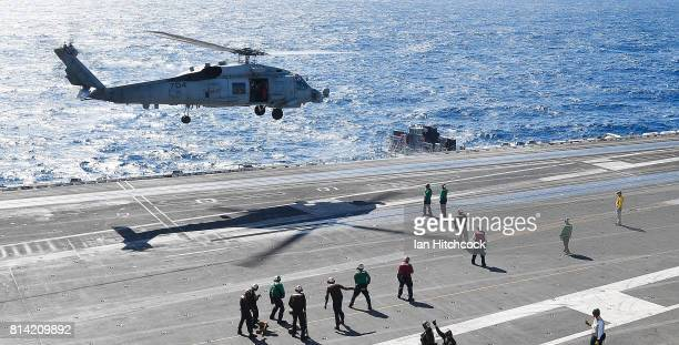 Navy Seahawk helicopter takes off from the deck of the USS Ronald Reagan on July 14 2017 in Townsville Australia USS Ronald Reagan is a 1092 foot...