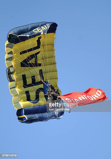 Navy Seal skydives off a plane to deliver the game balls before the start of a NCAA football game between the Washington State Cougars and the...