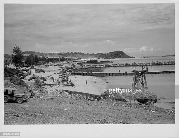A Navy seaplane base under construction in Okinawa during the Pacific Campaign of World War Two Japan 1945