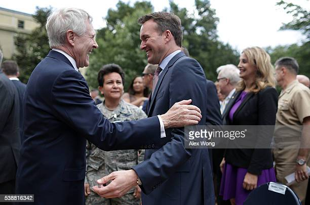 S Navy Secretary Ray Mabus talks to Army Secretary Eric Fanning during a Lesbian Gay Bisexual and Transgender Pride Month Ceremony at the Pentagon...